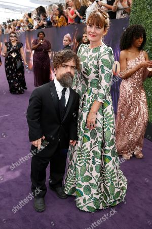 Peter Dinklage, Erica Schmidt. Peter Dinklage, left, and Erica Schmidt arrive at the 71st Primetime Emmy Awards, at the Microsoft Theater in Los Angeles