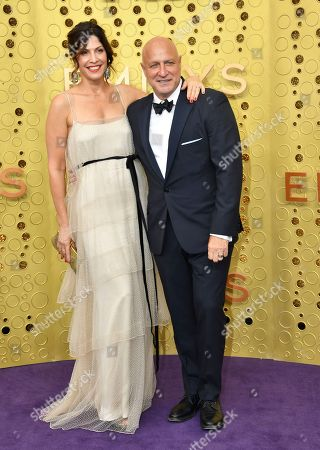 Stock Image of Lori Silverbush, Tom Colicchio. Lori Silverbush, left, and Tom Colicchio arrive at the 71st Primetime Emmy Awards, at the Microsoft Theater in Los Angeles