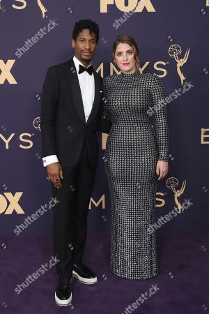 Stock Photo of Jon Batiste, left, and Suleika Jaouad arrive at the 71st Primetime Emmy Awards, at the Microsoft Theater in Los Angeles
