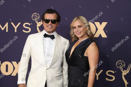 John Leguizamo, left, and Justine Maurer arrive at the 71st Primetime Emmy Awards, at the Microsoft Theater in Los Angeles