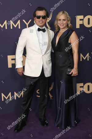 Stock Photo of John Leguizamo, left, and Justine Maurer arrive at the 71st Primetime Emmy Awards, at the Microsoft Theater in Los Angeles