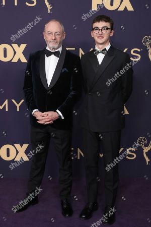 Liam Cunningham, left, and Isaac Hempstead Wright arrive at the 71st Primetime Emmy Awards, at the Microsoft Theater in Los Angeles