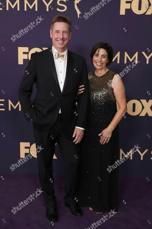 Stock Image of Mark Cendrowski, left, arrives at the 71st Primetime Emmy Awards, at the Microsoft Theater in Los Angeles