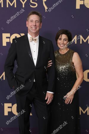 Mark Cendrowski, left, arrives at the 71st Primetime Emmy Awards, at the Microsoft Theater in Los Angeles