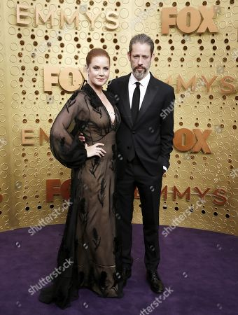 Amy Adams (L) and Darren Le Gallo (R) arrives for the 71st annual Primetime Emmy Awards ceremony held at the Microsoft Theater in Los Angeles, California, USA, 22 September 2019. The Primetime Emmys celebrate excellence in national primetime television broadcasting.
