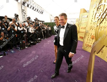 Anna Elisabet Eberstein, Hugh Grant. Anna Elisabet Eberstein and Hugh Grant arrive at the 71st Primetime Emmy Awards, at the Microsoft Theater in Los Angeles