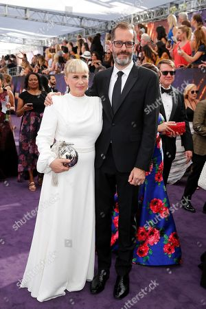 Patricia Arquette, Eric White. Patricia Arquette, left, and Eric White arrive at the 71st Primetime Emmy Awards, at the Microsoft Theater in Los Angeles