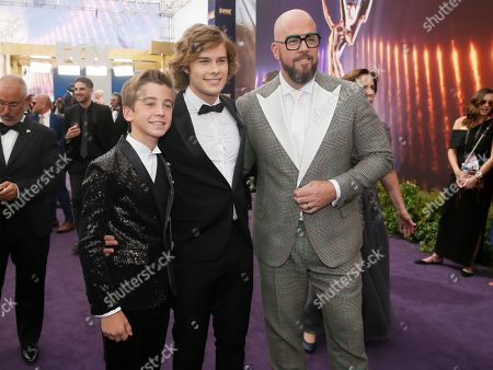 Parker Bates, Logan Shroyer, Chris Sullivan. Parker Bates, from left, Logan Shroyer and Chris Sullivan arrive at the 71st Primetime Emmy Awards, at the Microsoft Theater in Los Angeles