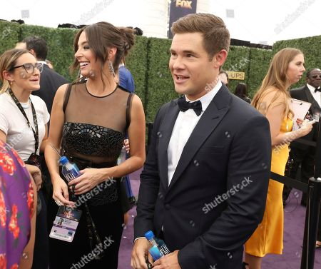 Adam Devine, Chloe Bridges. Adam Devine, right, and Chloe Bridges arrives at the 71st Primetime Emmy Awards, at the Microsoft Theater in Los Angeles