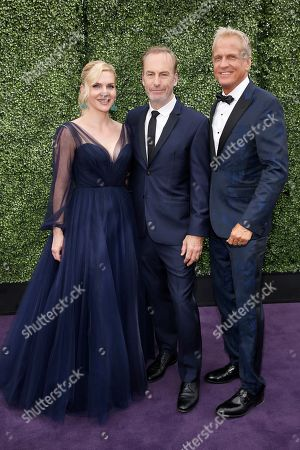 From left, Rhea Seehorn, Bob Odenkirk, and Patrick Fabian arrive at the 71st Primetime Emmy Awards, at the Microsoft Theater in Los Angeles