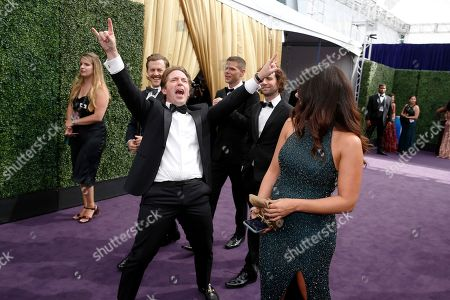 Beck Bennett, center left, arrives at the 71st Primetime Emmy Awards, at the Microsoft Theater in Los Angeles