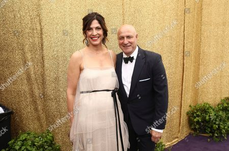 Stock Image of Lori Silverbush, Tom Colicchio. Lori Silverbush, left, and Tom Colicchio at the 71st Primetime Emmy Awards, at the Microsoft Theater in Los Angeles