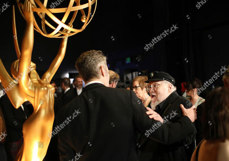 David Benioff, George R. R. Martin. David Benioff, left, and George R. R. Martin appear backstage at the 71st Primetime Emmy Awards, at the Microsoft Theater in Los Angeles