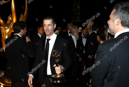 """D. B. Weiss, winner of the award for outstanding drama series for """"Game Of Thrones"""" appears backstage at the 71st Primetime Emmy Awards, at the Microsoft Theater in Los Angeles"""