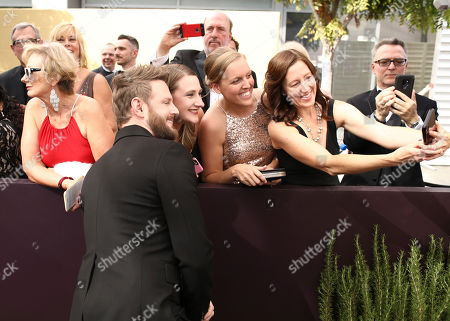 Bobby Berk takes selfies with fans at the 71st Primetime Emmy Awards, at the Microsoft Theater in Los Angeles