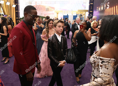 Lyric Ross, Sterling K. Brown, Parker Bates. Sterling K. Brown, from left, Parker Bates and Lyric Ross appear on the red carpet at the 71st Primetime Emmy Awards, at the Microsoft Theater in Los Angeles