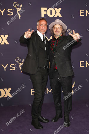 Jean Marc-Vallee (L) and Nathan Ross (R) arrive for the 71st annual Primetime Emmy Awards ceremony held at the Microsoft Theater in Los Angeles, California, USA, 22 September 2019. The Primetime Emmys celebrate excellence in national primetime television broadcasting.