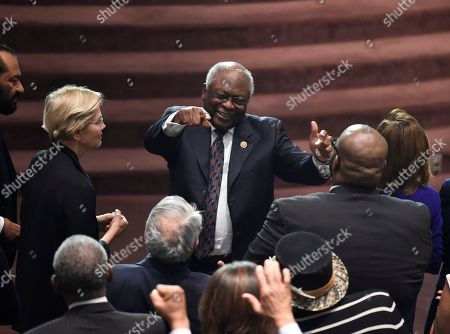 House Majority Whip Jim Clyburn greets other members of Congress at the funeral of his wife, Emily Clyburn, in West Columbia, S.C. Emily Clyburn, who helped raise millions of dollars to help students attend the alma mater she and her husband shared, died Thursday, Sept. 19 at age 80 after a decades-long battle with diabetes
