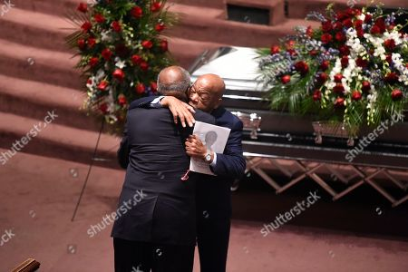 U.S. Rep. John Lewis, holding program, greets Majority Whip Jim Clyburn at funeral services for Clyburn's wife, Emily, in West Columbia, S.C. Emily Clyburn, who helped raise millions of dollars to help students attend the alma mater she and her husband shared, died Thursday, Sept. 19 at age 80 after a decades-long battle with diabetes