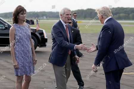 President Donald Trump greets Sen. Rob Portman, R-Ohio, and his wife Jane as he arrives at Lima Allen Airport to participate in a tour of Pratt Industries with Australian Prime Minister Scott Morrison, in Lima, Ohio