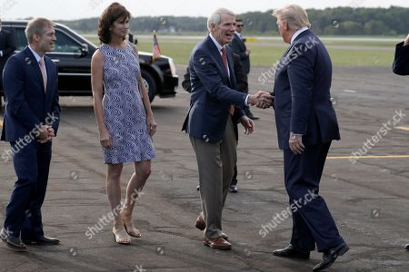 President Donald Trump greets Sen. Rob Portman and his wife Jane as Rep. Jim Jordan, R-Ohio, watches as he arrives at Lima Allen Airport to participate in a tour of Pratt Industries with Australian Prime Minister Scott Morrison, in Lima, Ohio