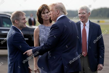 President Donald Trump greets Rep. Jim Jordan, R-Ohio, as Sen. Rob Portman, R-Ohio, and his wife Jane watch as he arrives at Lima Allen Airport to participate in a tour of Pratt Industries with Australian Prime Minister Scott Morrison, in Lima, Ohio