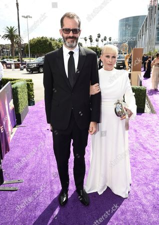 Eric White, Patricia Arquette. Eric White, left, and Patricia Arquette arrive at the 71st Primetime Emmy Awards, at the Microsoft Theater in Los Angeles