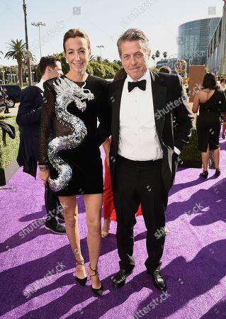 Hugh Grant, Anna Elisabet Eberstein. Hugh Grant, left, and Anna Elisabet Eberstein arrive at the 71st Primetime Emmy Awards, at the Microsoft Theater in Los Angeles