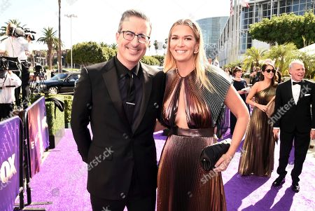 John Oliver, Kate Norley. John Oliver, left, and Kate Norley arrive at the 71st Primetime Emmy Awards, at the Microsoft Theater in Los Angeles