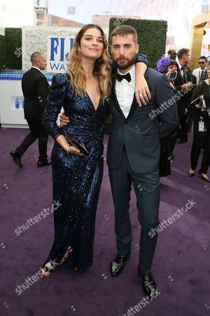 Annie Murphy, Dustin Milligan. Annie Murphy and Dustin Milligan arrive at the 71st Primetime Emmy Awards, at the Microsoft Theater in Los Angeles