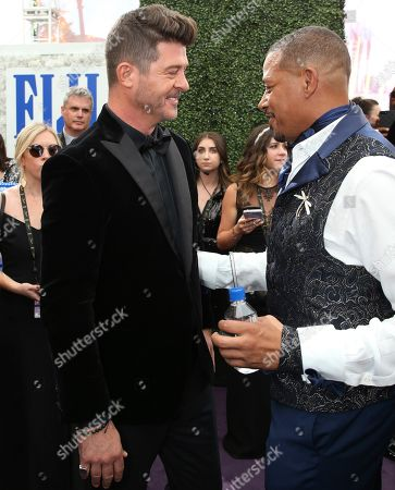 Robin Thicke, Terrence Howard. Robin Thicke and Terrence Howard arrive at the 71st Primetime Emmy Awards, at the Microsoft Theater in Los Angeles