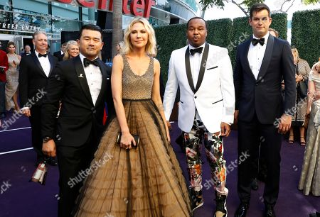 Stock Photo of Ronny Chieng, Desi Lydic, Roy Wood Jr....., Michael Kosta. Ronny Chieng, Desi Lydic, Roy Wood Jr..... and Michael Kosta arrive at the 71st Primetime Emmy Awards, at the Microsoft Theater in Los Angeles