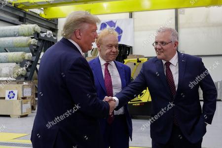 Donald Trump Scott Morrison. President Donald Trump shakes hands with Australian Prime Minister Scott Morrison as Pratt Industries chairman Anthony Pratt watches during a tour of Pratt Industries, in Wapakoneta, Ohio