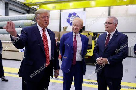 Donald Trump Scott Morrison. President Donald Trump speaks as Australian Prime Minister Scott Morrison and Pratt Industries chairman Anthony Pratt, center, watch during a tour of Pratt Industries, in Wapakoneta, Ohio