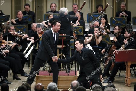 British bass-baritone David Soar (L), as Masetto, and Italian bass-baritone Luca Pisaroni (R), as Don Giovanni, perform with the Basel Chamber Orchestra in the Mozart's opera 'Don Giovanni' on the stage of the Romanian Athenaeum concert hall during the George Enescu International Festival 2019, in Bucharest, Romania, 22 September 2019. The festival, held every two years since 1958, is the biggest classical music festival held in Romania, in honor of Romanian composer and violinist George Enescu. The 24th edition of the George Enescu International Festival takes place between 31 August and 22 September 2019.