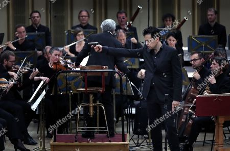 Stock Image of Italian bass-baritone Luca Pisaroni (R), as Don Giovanni, performs with the Basel Chamber Orchestra in the Mozart's opera 'Don Giovanni' on the stage of the Romanian Athenaeum concert hall during the George Enescu International Festival 2019, in Bucharest, Romania, 22 September 2019.The festival, held every two years since 1958, is the biggest classical music festival held in Romania, in honor of Romanian composer and violinist George Enescu. The 24th edition of the George Enescu International Festival takes place between 31 August and 22 September 2019.