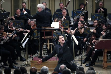 Stock Picture of Italian bass-baritone Luca Pisaroni, as Don Giovanni, performs the final scene with the Basel Chamber Orchestra in the Mozart's opera 'Don Giovanni' on the stage of the Romanian Athenaeum concert hall during the George Enescu International Festival 2019, in Bucharest, Romania, 22 September 2019. The festival, held every two years since 1958, is the biggest classical music festival held in Romania, in honor of Romanian composer and violinist George Enescu. The 24th edition of the George Enescu International Festival takes place between 31 August and 22 September 2019.