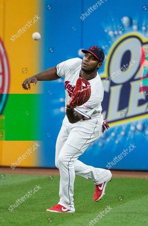 Cleveland Indians' Yasiel Puig catches a fly ball by Philadelphia Phillies' Jean Segura during the third inning of a baseball game in Cleveland
