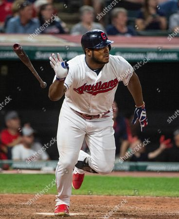 Cleveland Indians' Yasiel Puig watches his three-run double off of Philadelphia Phillies relief pitcher Cole Irvin during the seventh inning of a baseball game in Cleveland