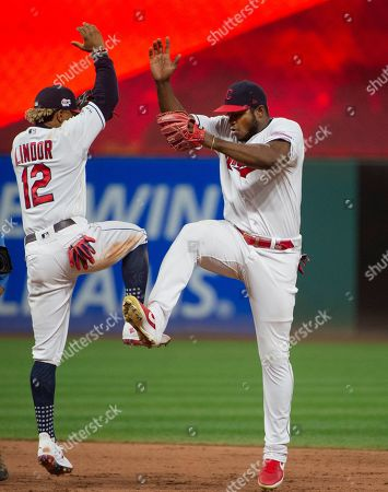 Cleveland Indians' Francisco Lindor and Yasiel Puig celebrate a 10-1 win over the Philadelphia Phillies at a baseball game in Cleveland