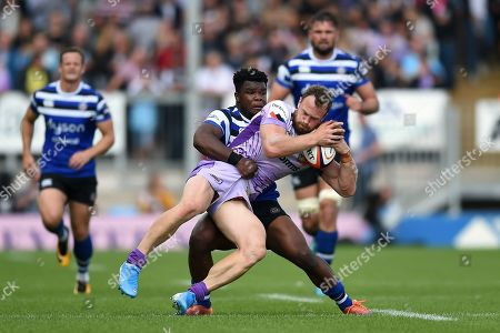 James Short of Exeter Chiefs is tackled by Levi Davis of Bath Rugby