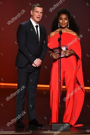 Peter Krause, Angela Bassett. Peter Krause, left, and Angela Bassett present the award for outstanding lead actor in a limited series or movie at the 71st Primetime Emmy Awards, at the Microsoft Theater in Los Angeles