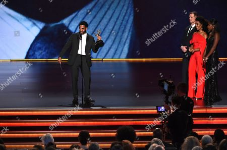 """Jharrel Jerome, Peter Krause, Angela Bassett. Jharrel Jerome, from left, accepts the award for outstanding lead actor in a limited series or movie for """"When They See Us"""" as Peter Krause and Angela Bassett look on at the 71st Primetime Emmy Awards, at the Microsoft Theater in Los Angeles"""