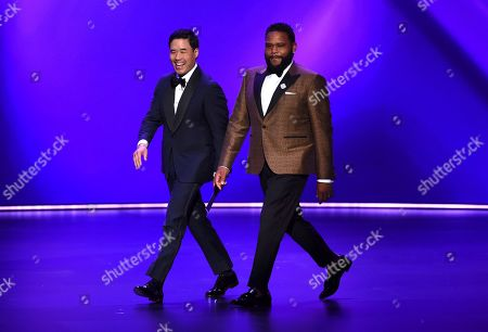 Randall Park, Anthony Anderson. Randall Park, left, and Anthony Anderson walk onstage at the 71st Primetime Emmy Awards, at the Microsoft Theater in Los Angeles