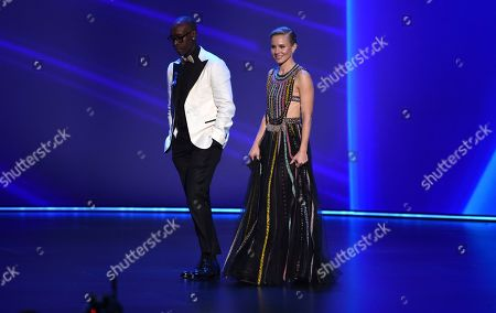 Don Cheadle, Kristen Bell. Don Cheadle, left, and Kristen Bell walk onstage at the 71st Primetime Emmy Awards, at the Microsoft Theater in Los Angeles