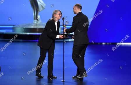 """Jesse Armstrong, Cherry Jones. Cherry Jones, left, presents Jesse Armstrong with the award for outstanding writing for a drama series for """"Succession"""" at the 71st Primetime Emmy Awards, at the Microsoft Theater in Los Angeles"""
