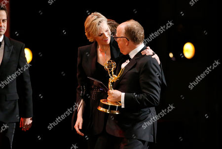 "Jane Lynch, Harry Bradbeer. Jane Lynch, left, and Harry Bradbeer, with the award for outstanding directing for a comedy series for ""Fleabag"", at the 71st Primetime Emmy Awards, at the Microsoft Theater in Los Angeles"