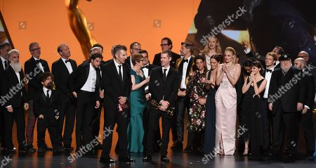 "David Benioff, D. B. Weiss, Carolyn Strauss, Bernadette Caulfield, Frank Doelger, David Nutter, Miguel Sapochnik, Vince Gerardis, Guyman Casady, George R. R. Martin, Bryan Cogman, Chris Newman, Greg Spence, Lisa McAtackney, Duncan Muggoch. The team from ""Game Of Thrones"" accepts the award for outstanding drama series at the 71st Primetime Emmy Awards, at the Microsoft Theater in Los Angeles"