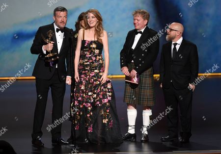 "David Slade, Charlie Brooker, Annabel Jones, Russell McLean. Charlie Brooker, from left, Annabel Jones, Russell McLean and David Slade accept the award for outstanding television movie for ""Black Mirror: Bandersnatch"" at the 71st Primetime Emmy Awards, at the Microsoft Theater in Los Angeles"