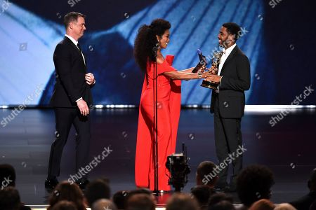 """Jharrel Jerome, Angela Bassett, Peter Krause. Jharrel Jerome, right, accepts the award for outstanding lead actor in a limited series or movie for """"When They See Us"""" as Angela Bassett and Peter Krause look on at the 71st Primetime Emmy Awards, at the Microsoft Theater in Los Angeles"""